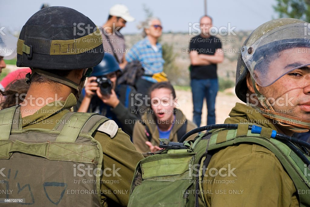 Israeli university student pleading with soldiers in Bil'in, West Bank stock photo