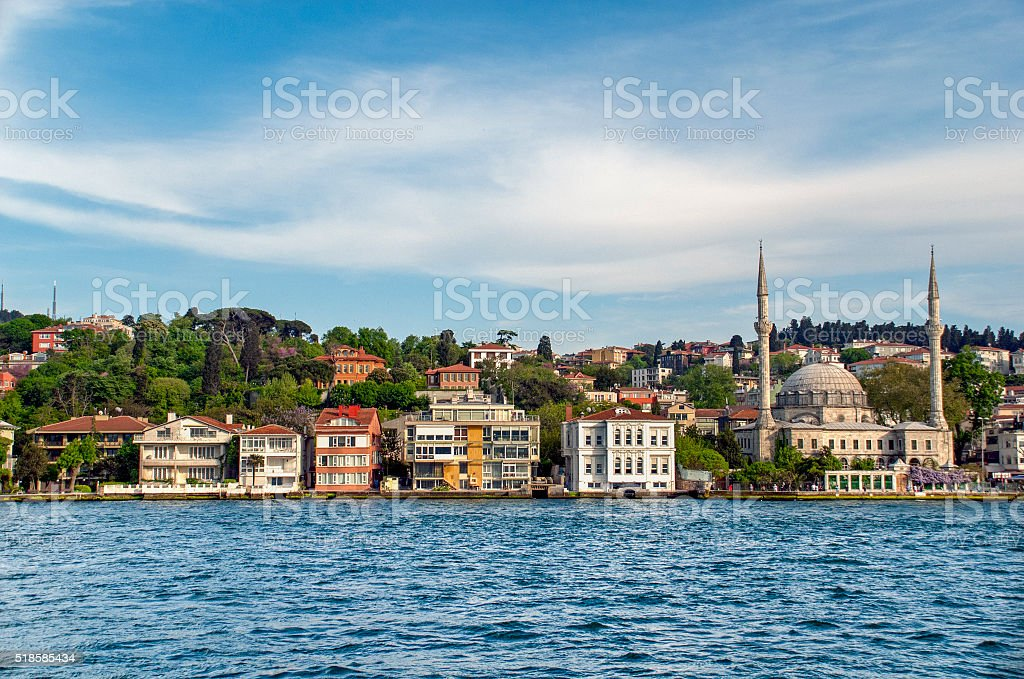 Istanbul houses on the sea dock with mosque stock photo