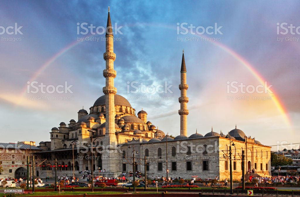 Istanbul - New Mosque, Yeni Cami in the evening with Rainbow, Eminonu district, Turkey stock photo