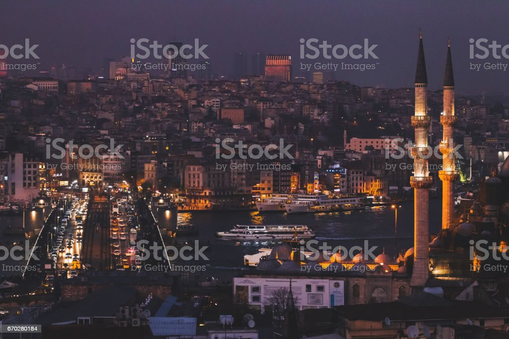 Istanbul night view from Valide Han roof. Illuminated lights stock photo
