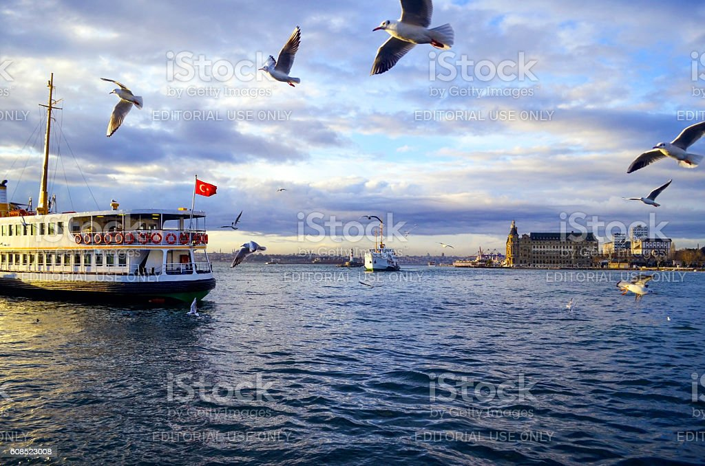 Istanbul throat historic Haydarpasa train station and the ferry. stock photo