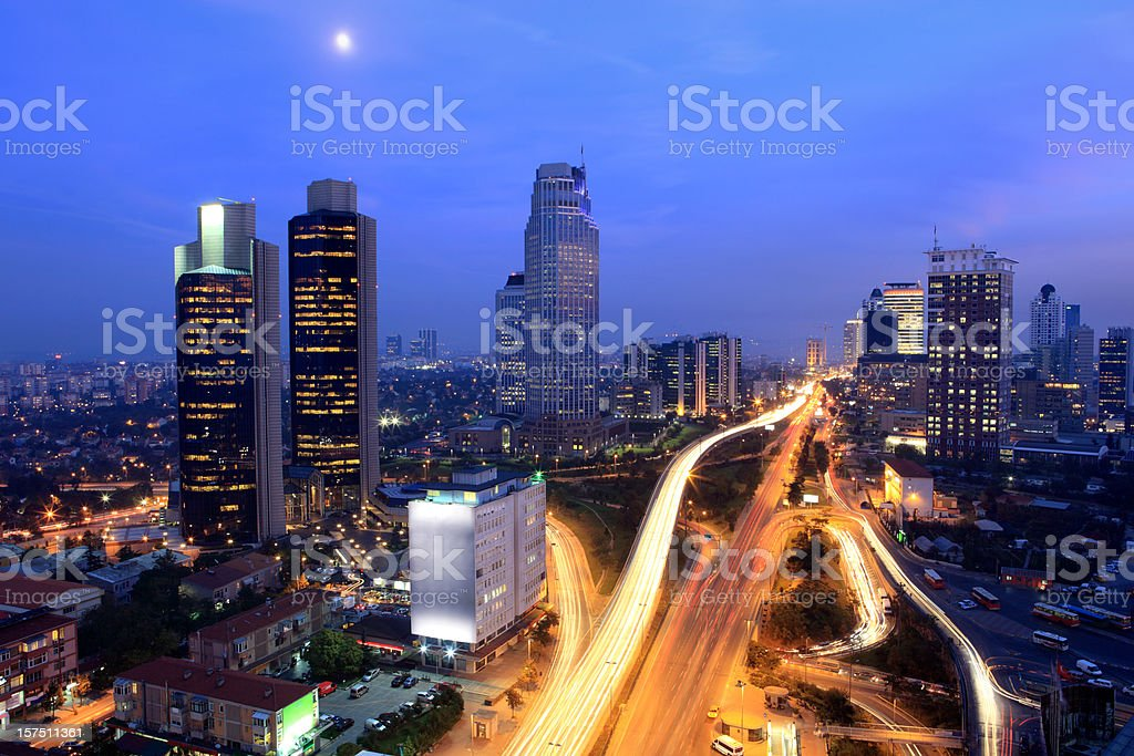 Istanbul's financial district lit up on a busy night royalty-free stock photo