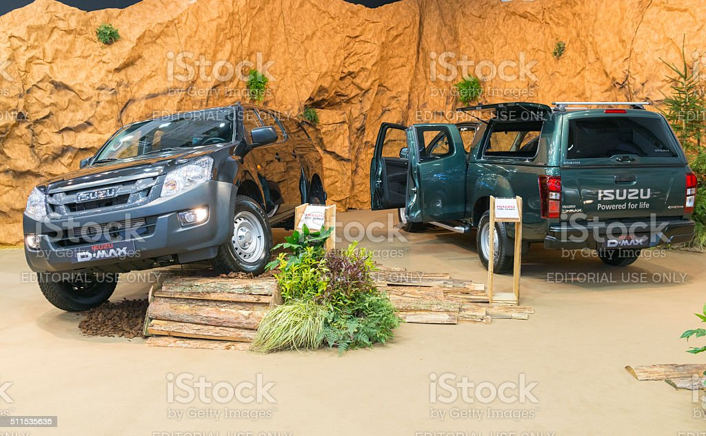 Black and green Isuzu D-max LxS 4x4 pick-up truck front and rear...