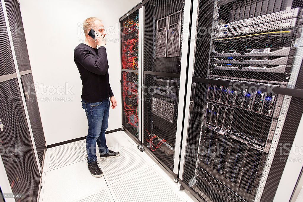 It consultant work in large datacenter stock photo