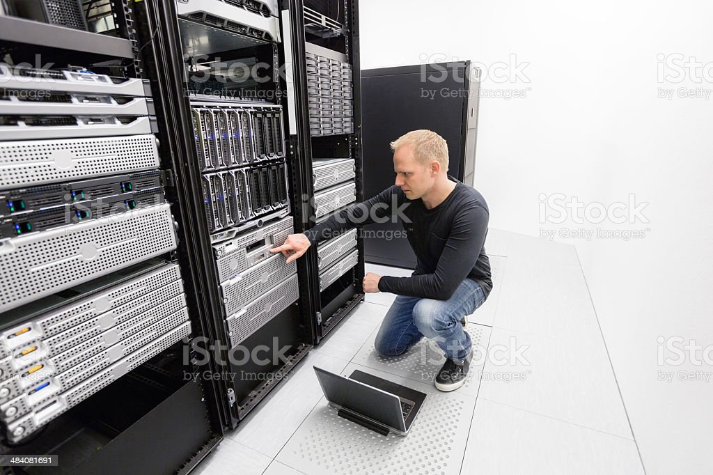 It consultant work with backup in datacenter stock photo