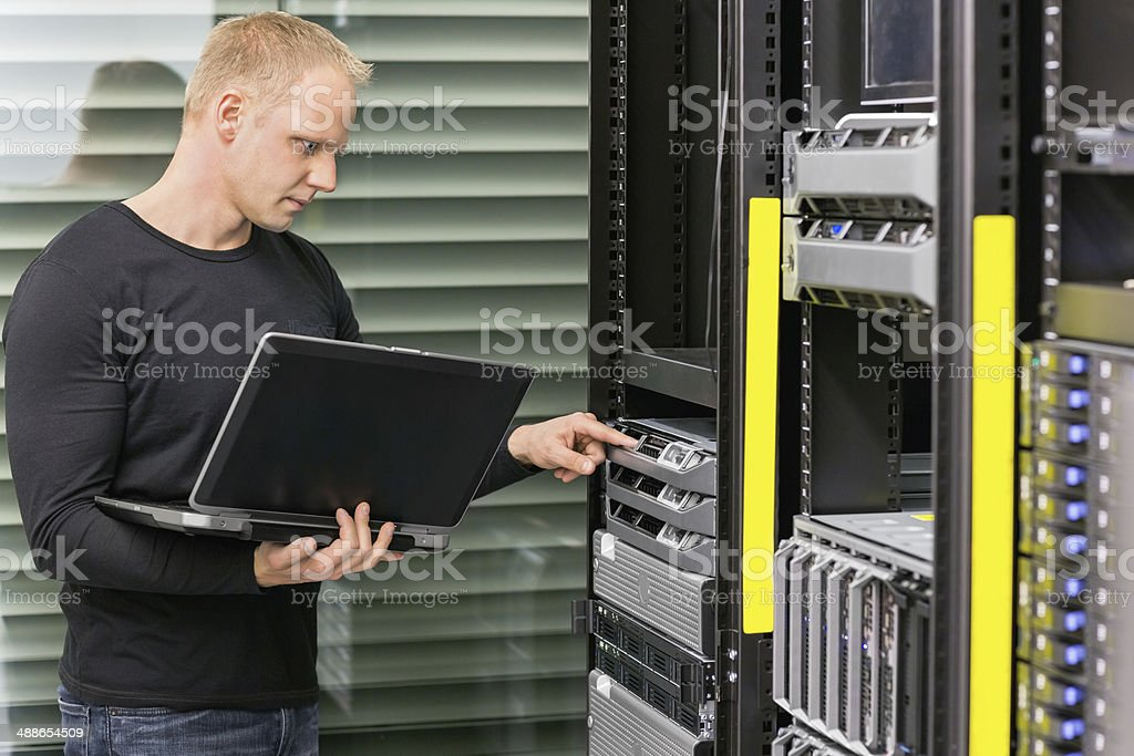 It consultant working with servers stock photo