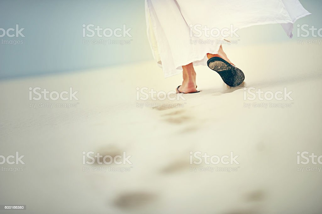 It is in difficult times that He carries you stock photo