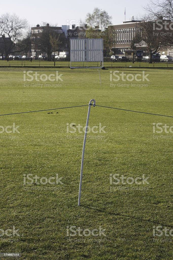 Cricket sightscreen and pitch roped off with plastic binder twin stock photo