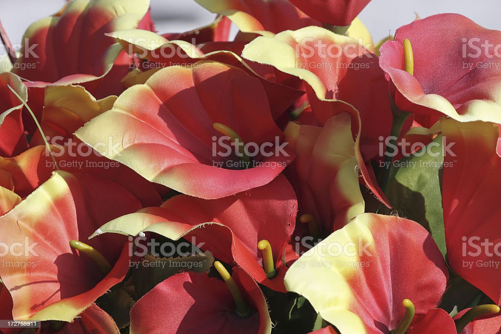 False artificial flowers in yellow and red royalty-free stock photo