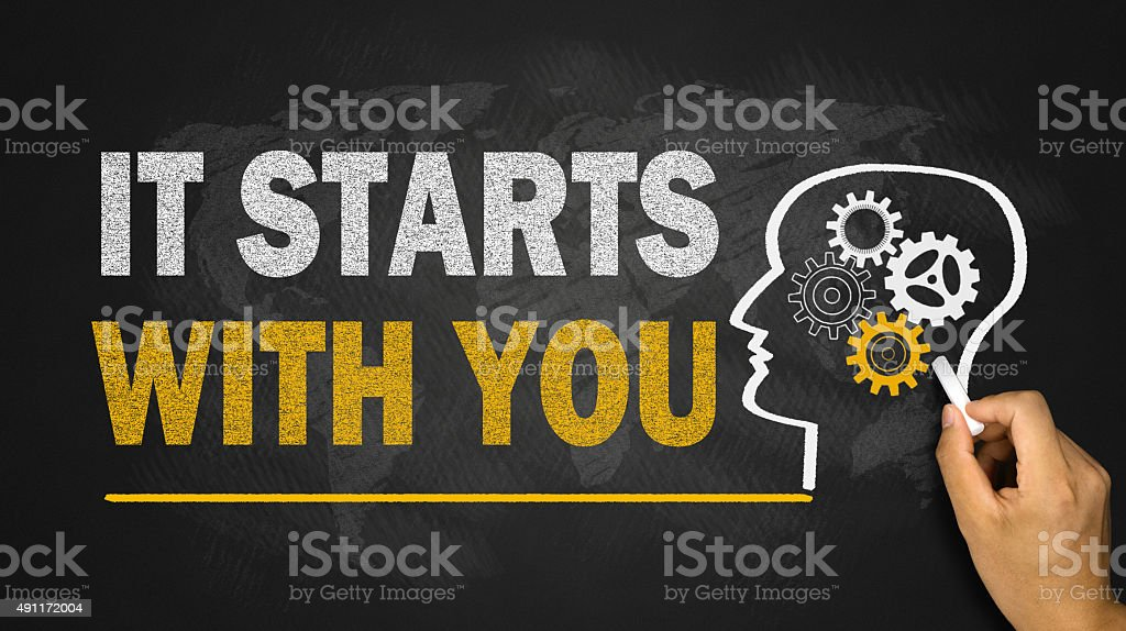it starts with you concept on blackboard stock photo