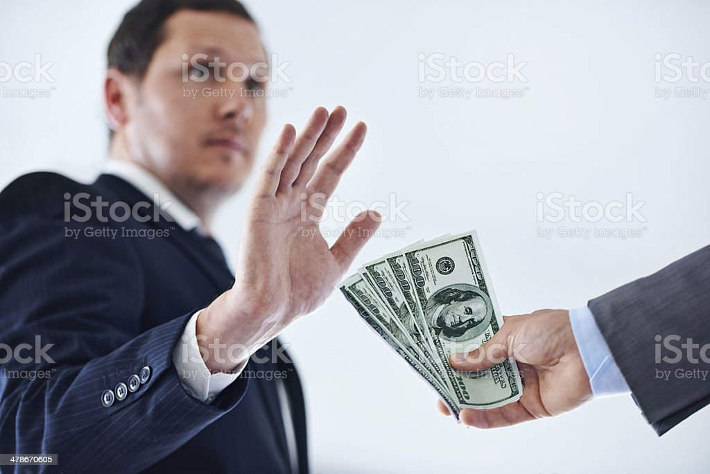 It takes a strong man to refuse bribes stock photo