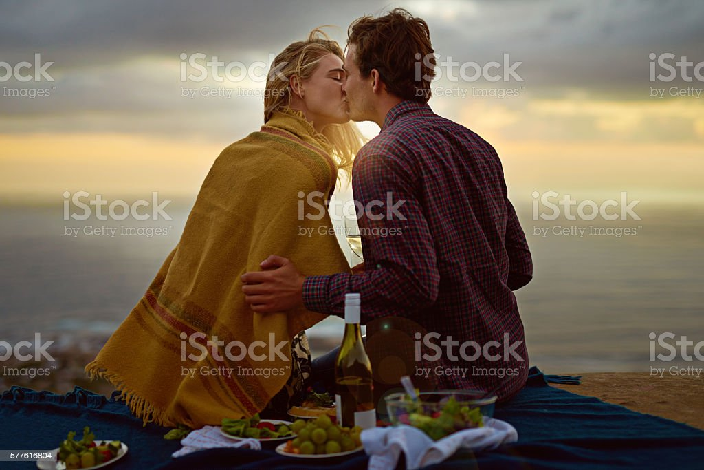It was the perfect moment for their first kiss stock photo