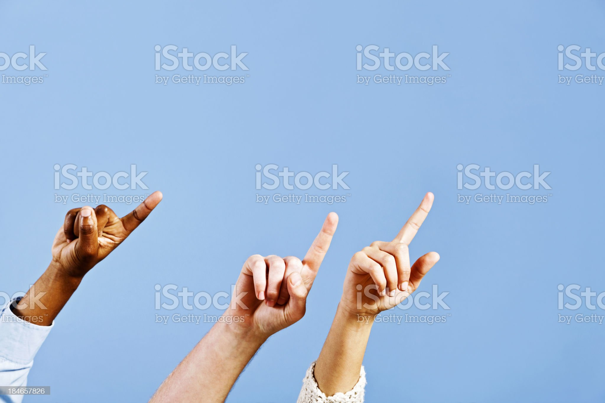It went thataway! Three hands point upwards at an angle royalty-free stock photo