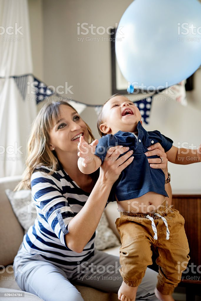 It wouldn't be a birthday party without balloon fun stock photo