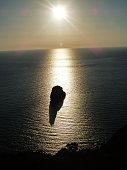 Italia, Sardegna, Masua, faraglione in contro luce