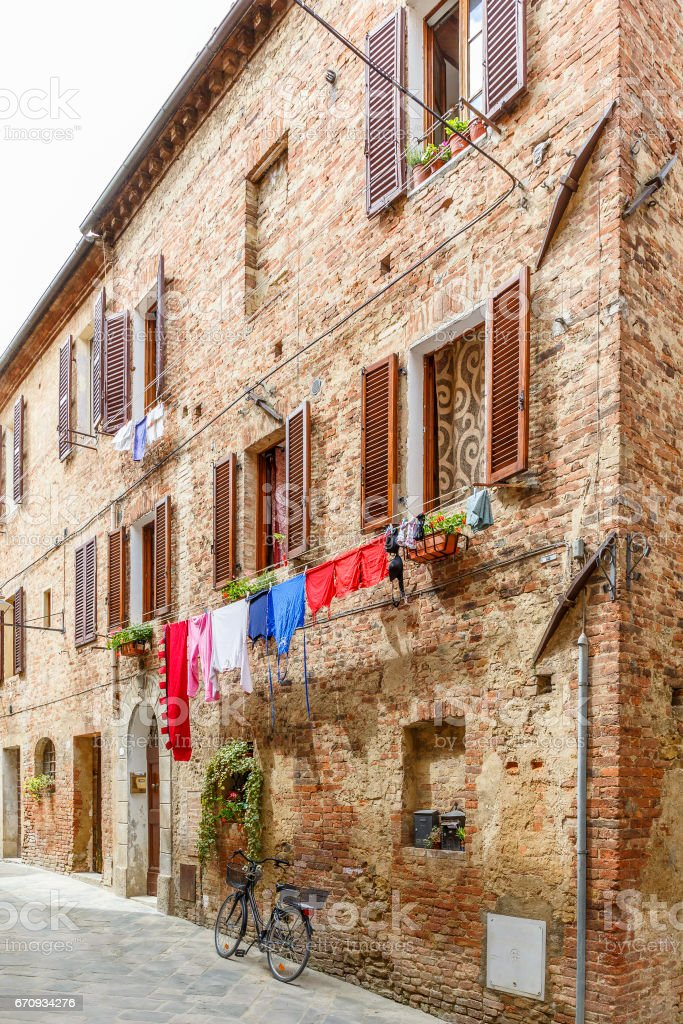 Italian alleyway with hanging laundry and a parked bicycle stock photo