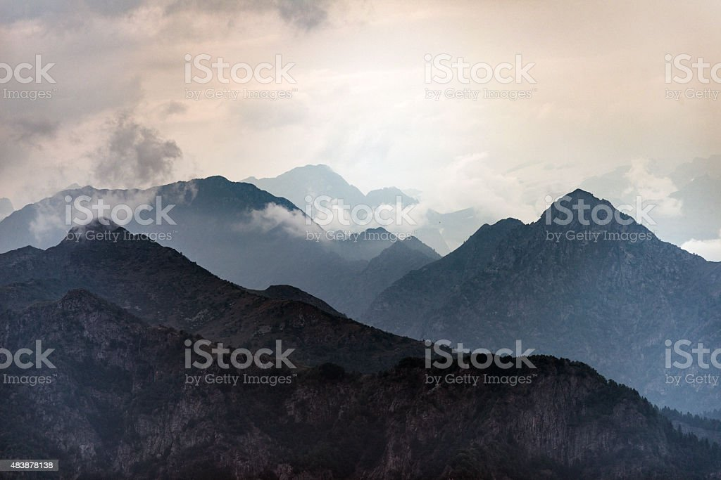 Italian Alps mountains misty landscape stock photo