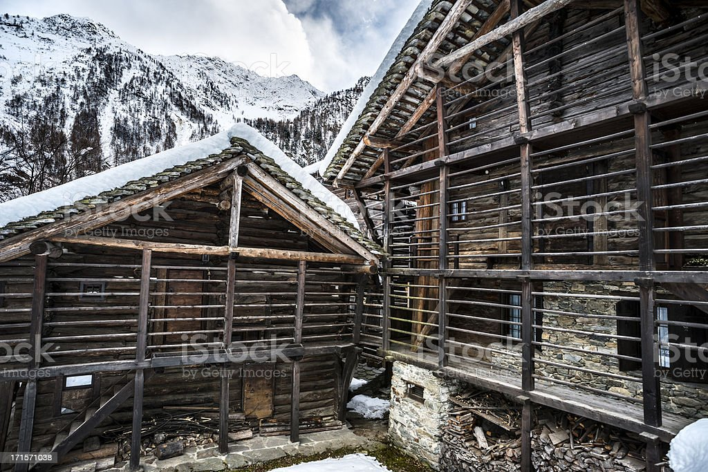 Italian Alps typical Walser house winter scene stock photo