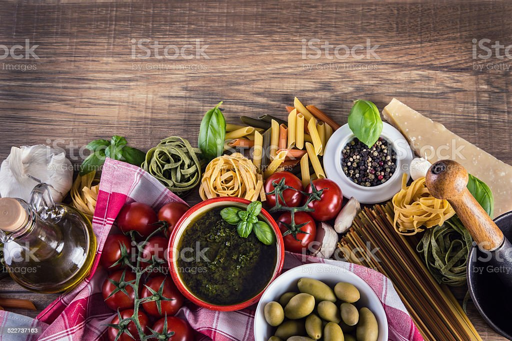 Italian and Mediterranean food ingredients on old wooden background. stock photo