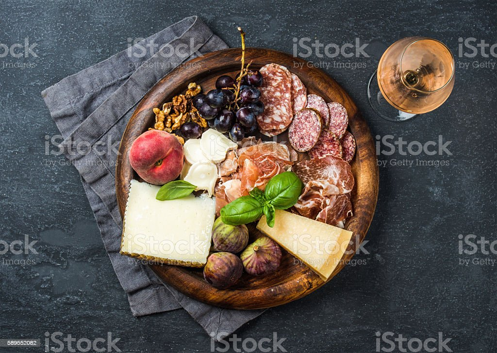 Italian antipasti snack for wine on wooden tray, dark background stock photo