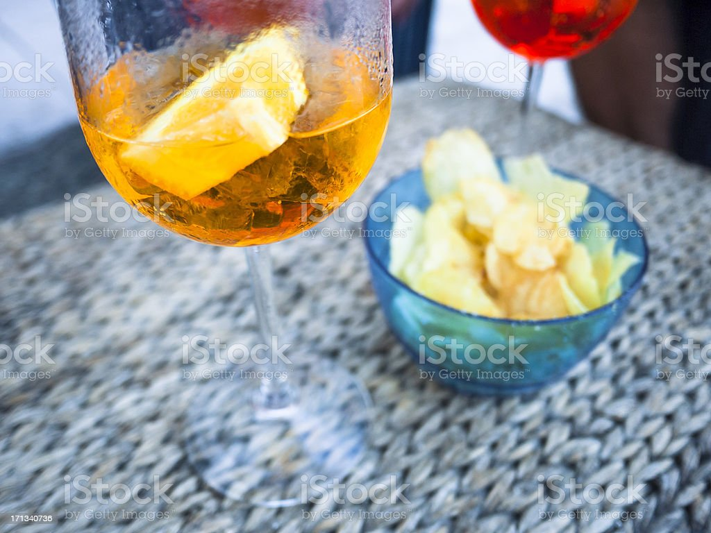 Italian aperitif with drinks and chips royalty-free stock photo