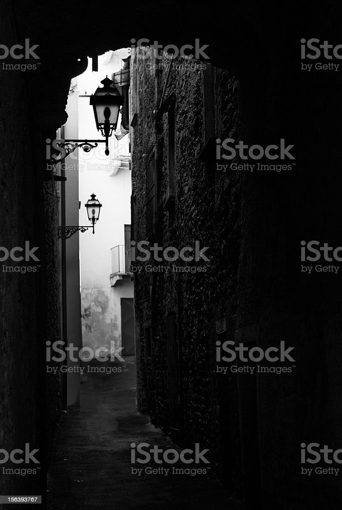 Italian architecture backlit arc with street lantern lamps royalty-free stock photo