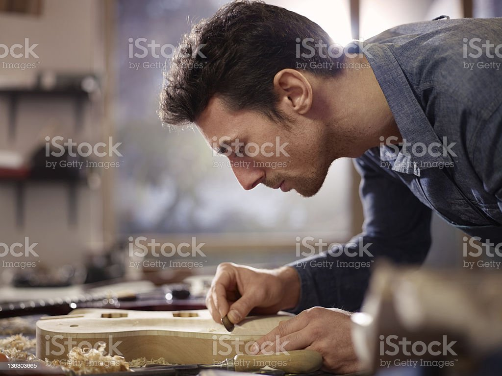 italian artisan working in lutemaker workshop stock photo