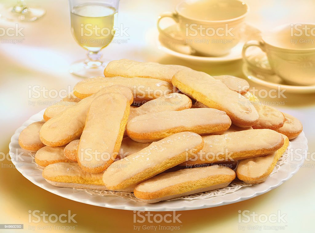 Italian biscuits savoiardi and tea for an afternoon snack stock photo