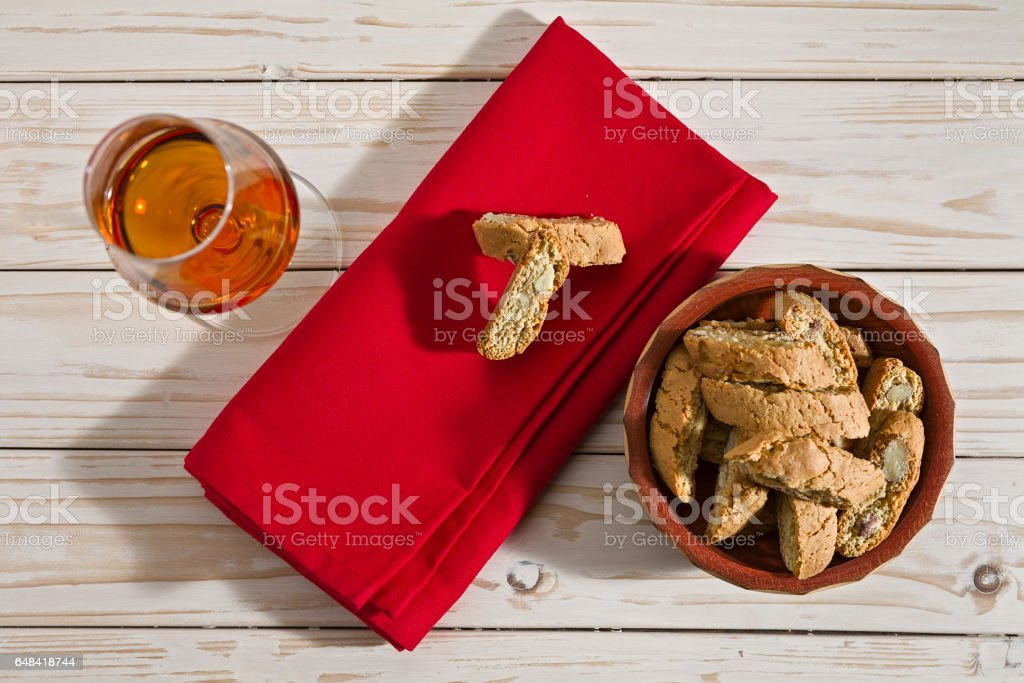 Italian cantucci biscuits and a glass of vin santo wine stock photo