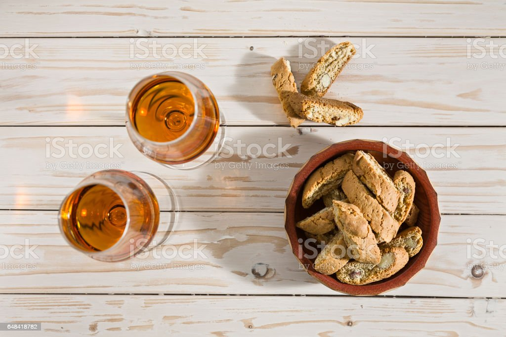 Italian cantucci biscuits and two glasses of vin santo wine stock photo