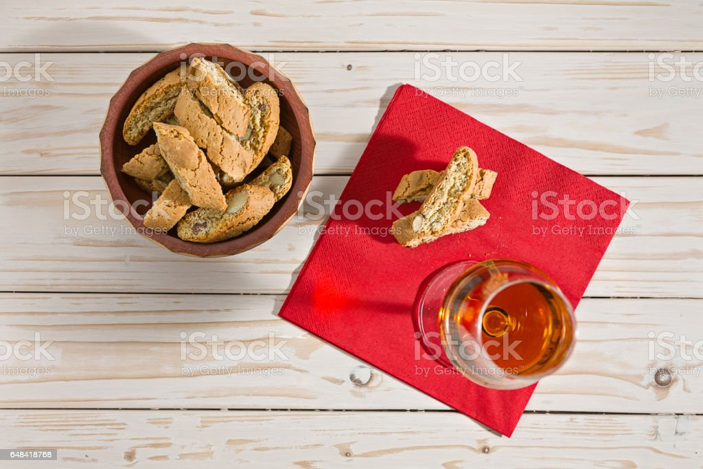 Italian cantucci biscuits and vin santo wine over a red napkin stock photo