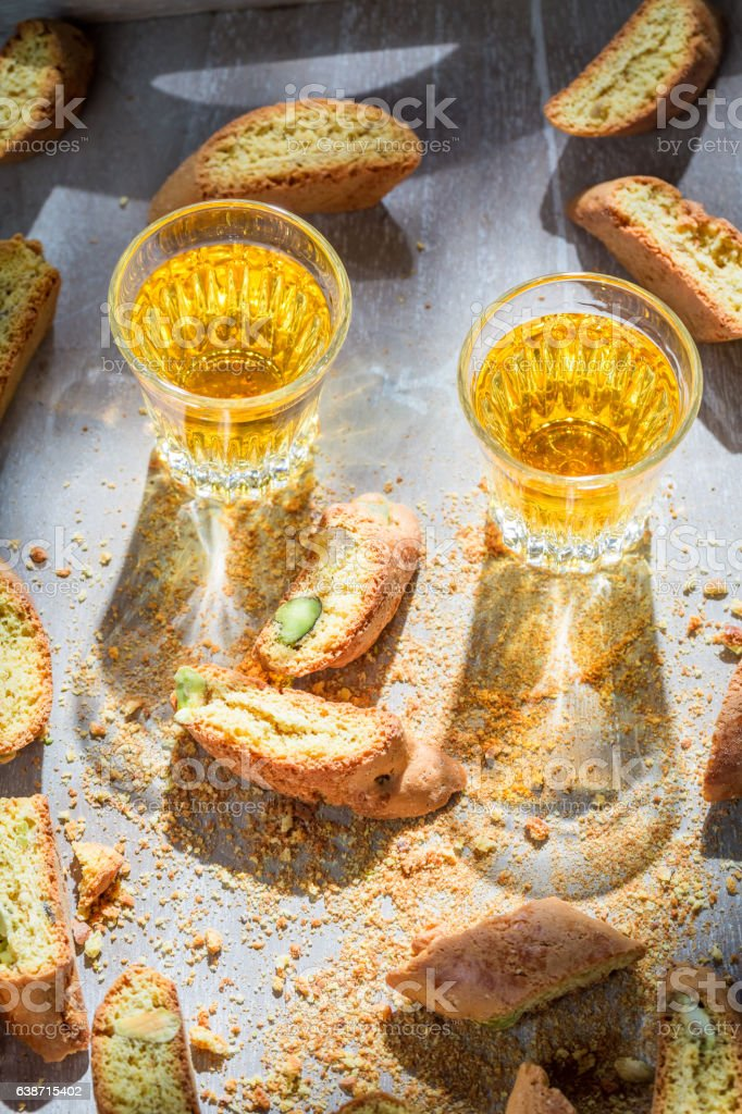 Italian cantucci with pistachios and Vin Santo wine stock photo