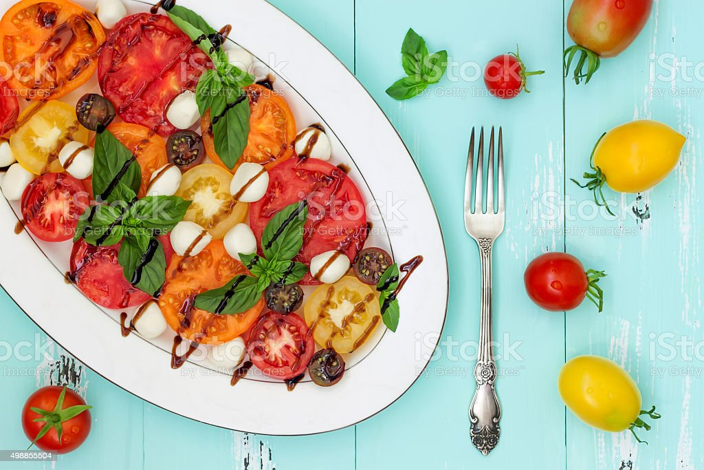 Italian caprese salad with mozarella cheese, tomatoes and basil stock photo