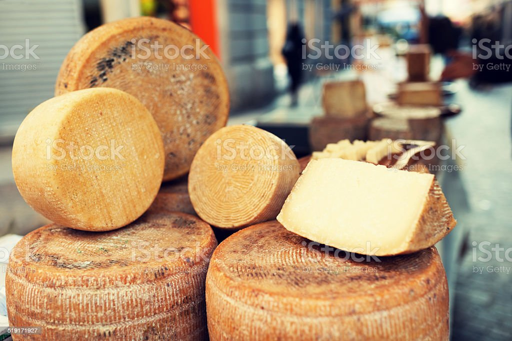 Italian cheese in sale at street market stock photo