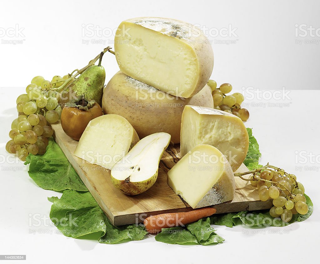 Italian cheese with pears and grapes royalty-free stock photo