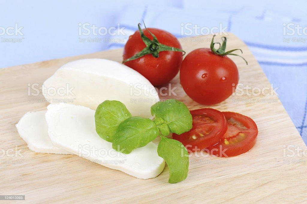 Italian Cheesse Mozzarella und Tomato Preparation for Salad stock photo