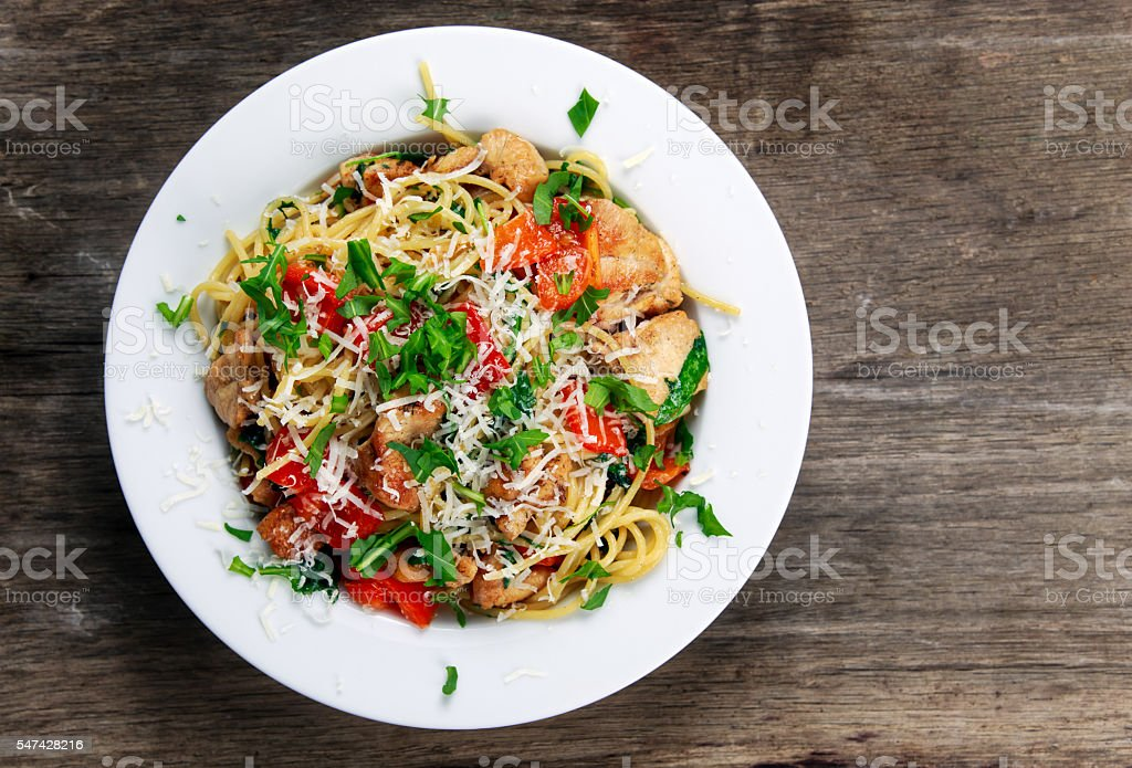 Italian Chicken Breast spaghetti, red pepper, Parmesan cheese, wild rocket. stock photo