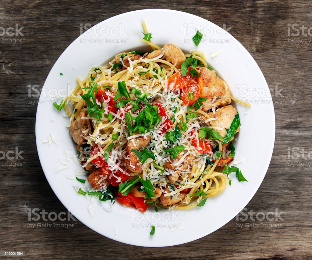Italian Chicken Breast spaghetti with pepper, Parmesan, wild rocket  lives. stock photo