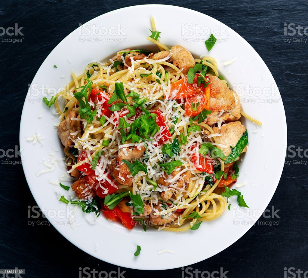 Italian Chicken Breast spaghetti with red pepper, Parmesan cheese and stock photo