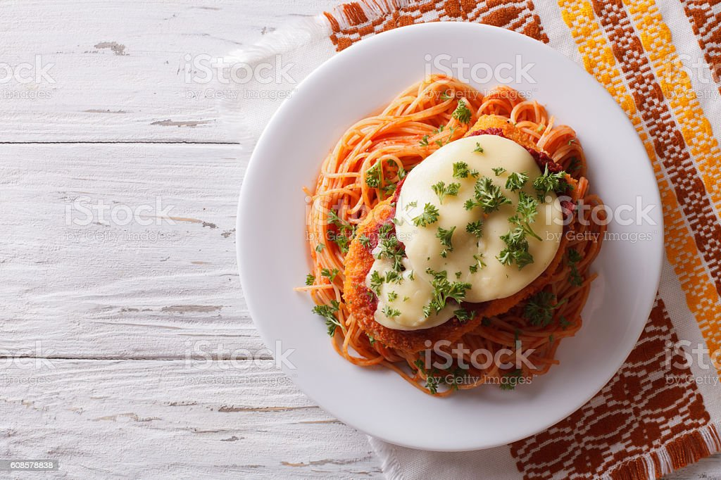 Italian chicken Parmigiana and pasta. Horizontal top view stock photo
