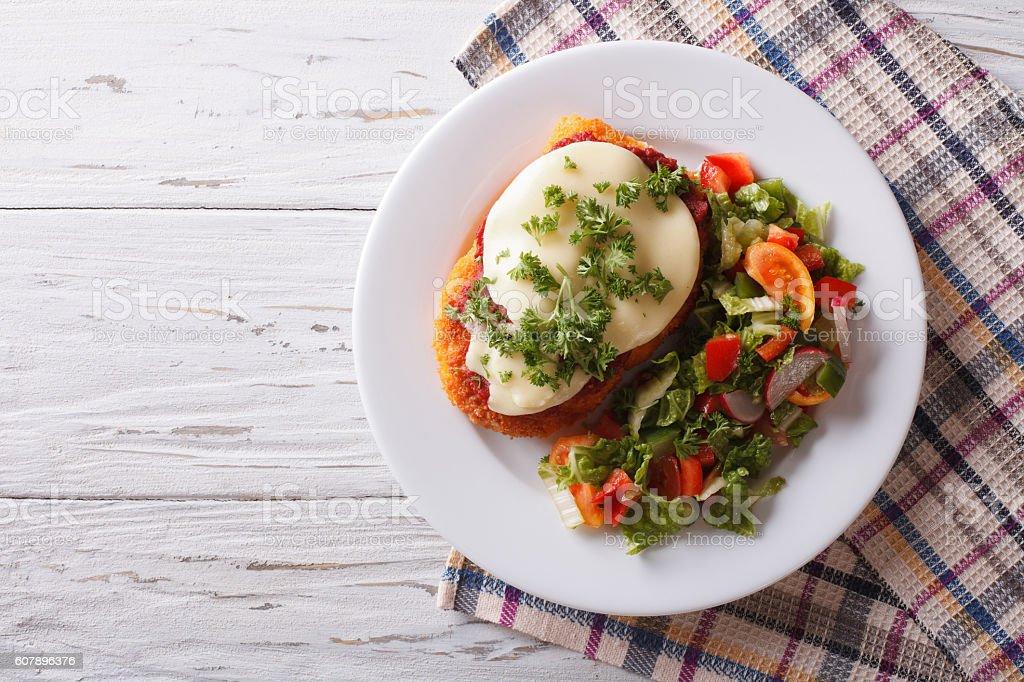 Italian chicken Parmigiana and salad. horizontal top view stock photo