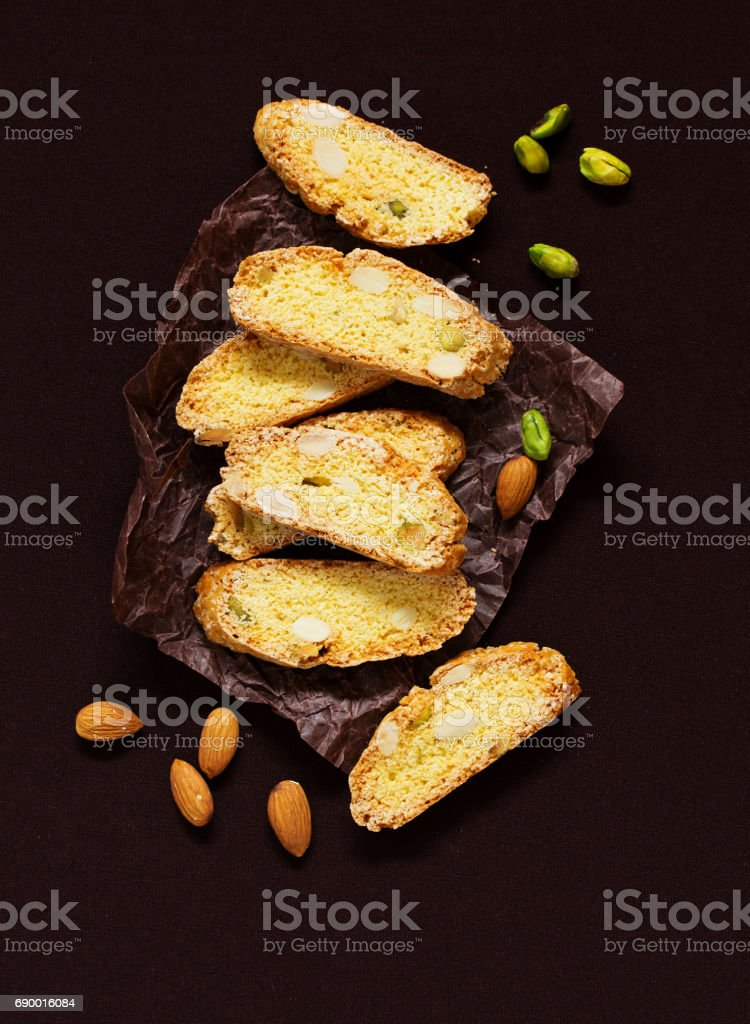Italian cookies (biscotti) with almonds and pistachios. Selective focus. stock photo