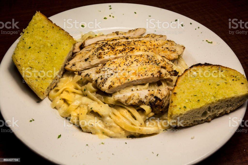 Italian Cuisine Chicken Alfredo Wit Garlic Bread stock photo