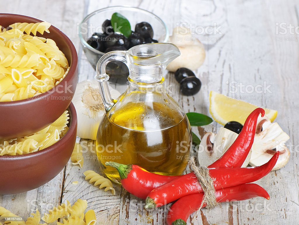 Italian cuisine - pasta and olive oil royalty-free stock photo
