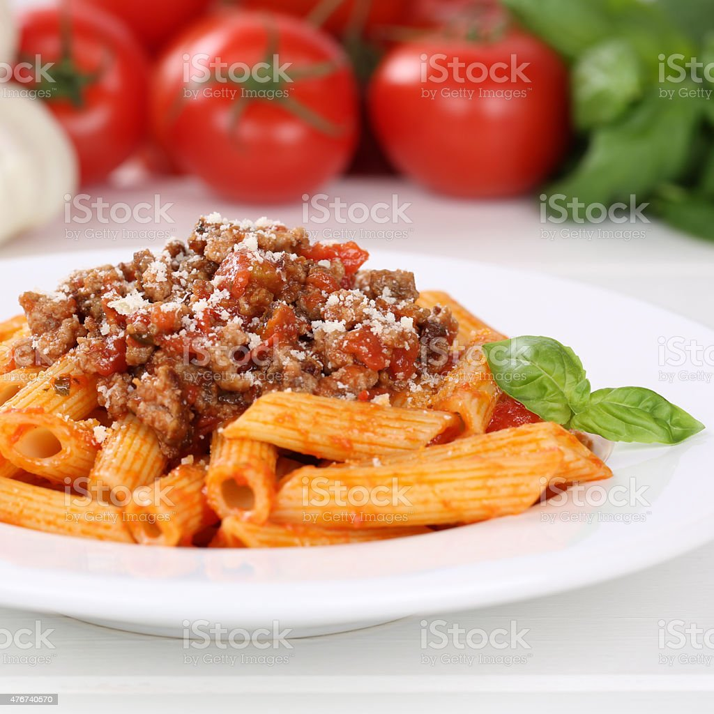 Italian cuisine Penne Rigate Bolognese sauce noodles pasta meal stock photo