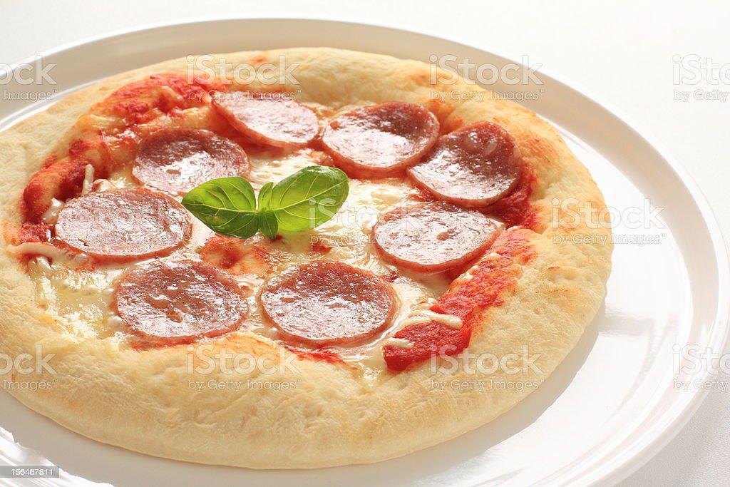 Italian cuisine, salami pizza royalty-free stock photo