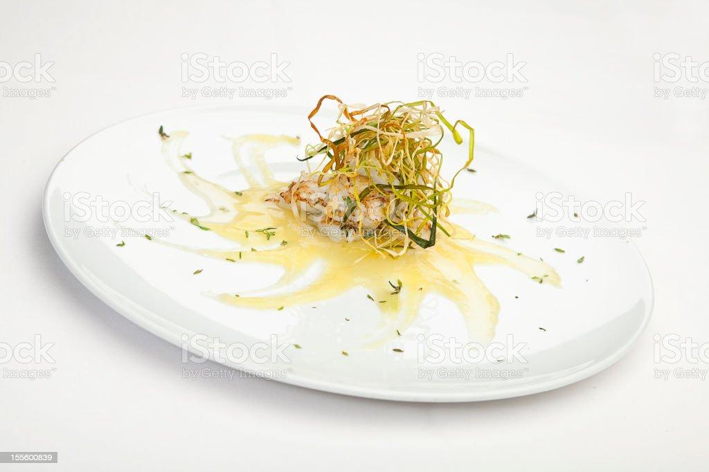 Italian cuisine series: Peter's fish with thyme on leak cream stock photo