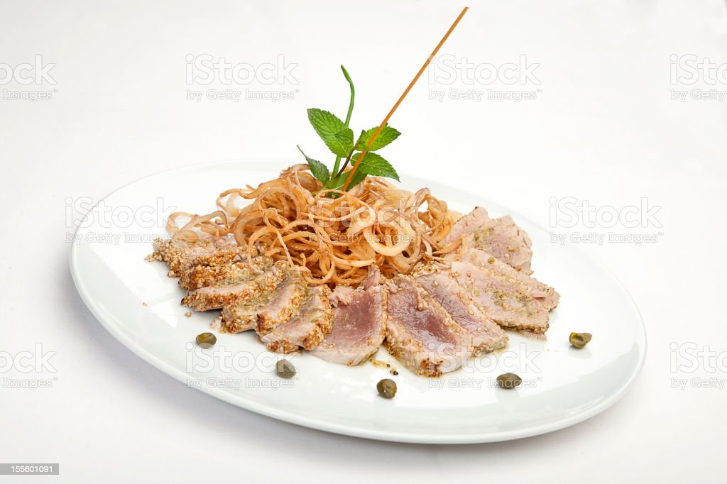 Italian cuisine series: Tuna fillet with sesame seeds, capers sauce stock photo