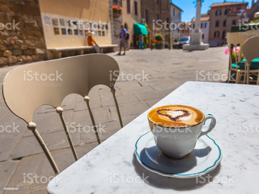 Italian Cup of Cappuccino at a Cafe Terrace with Street stock photo