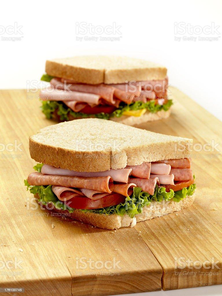 Italian Deli Sandwiches on a Cutting Board royalty-free stock photo